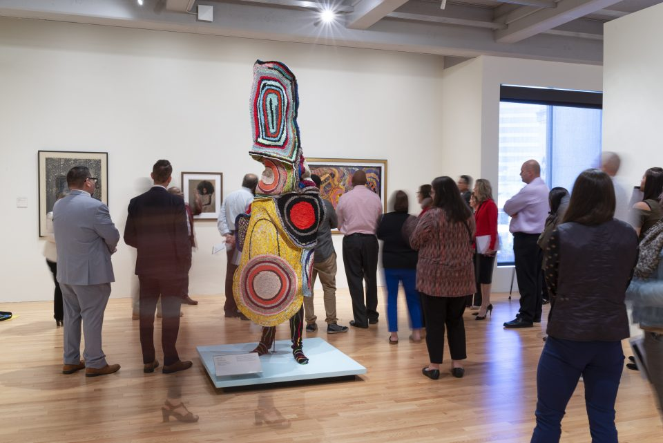 Visitors in the gallery during the Afrocosmologies opening reception
