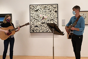 Photograph of James Prosek and Lindsey Fyfe performing in the galleries.