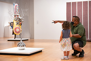Father and daughter viewing contemporary art