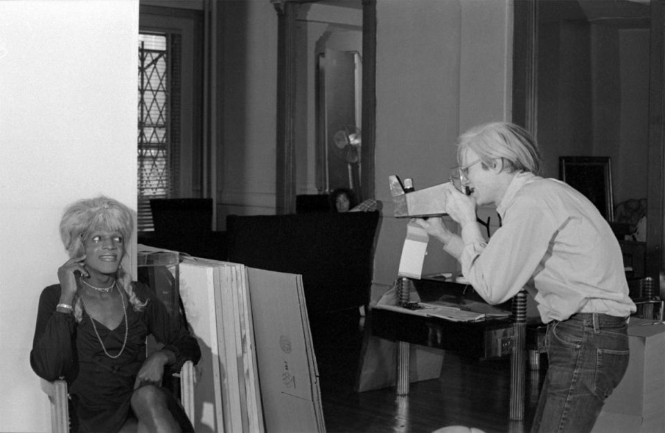 Ronnie Cutrone (American, 1948-2013),Andy Warhol Photographing a Drag Queen(Marsha P. Johnson), 1975. Photograph. Image courtesy of Skarstedt Gallery